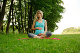 beautiful young pregnant woman in nature