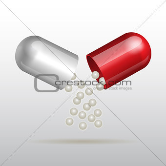 Small balls  pouring from an open medical capsule.