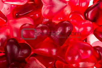 Brightly coloured red gummy hearts