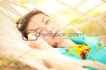 beautiful girl relaxes in a hammock
