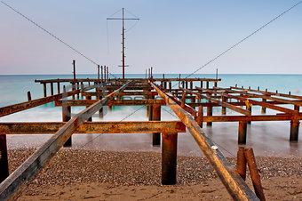 old rusty foundation pier at dawn