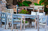 gray wooden furniture in an outdoor restaurant