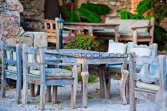 gray wooden furniture in an outdoor restaurant