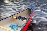 red canoe stern with a rope
