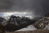 Snowy mountains and storm clouds