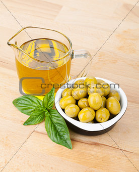 Olives, olive oil and basil