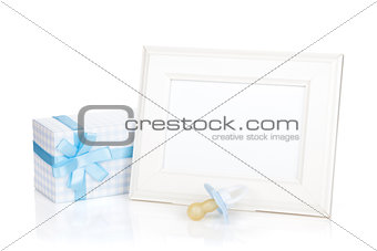 Photo frame with gift box and boy dummy