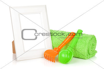 Photo frame with bath towel and toys