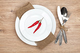 Red chili peppers on plate and silverware set