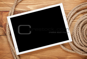 Blank photo frame with ship rope