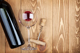 Red wine bottle glass and corkscrew