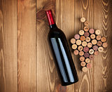 Red wine bottle and grape shaped corks
