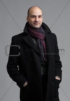 man in coat over gray background