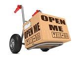 Open Me - Cardboard Box on Hand Truck.
