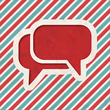 Speech Bubble Icon on Retro Striped Background.