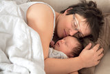 Mother and newborn baby asleep