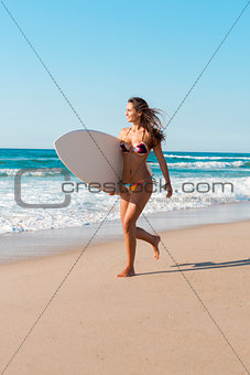 Surfer girl at the beach
