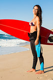 Surfer girl with her surfboard