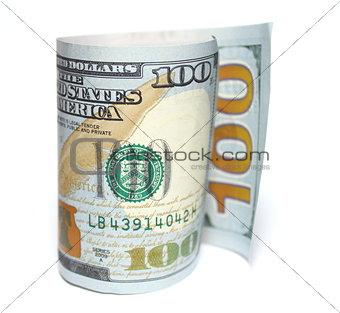 One hundred new dollars closeup on white background