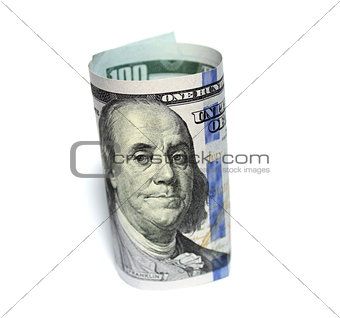 One hundred new dollars closeup on white background