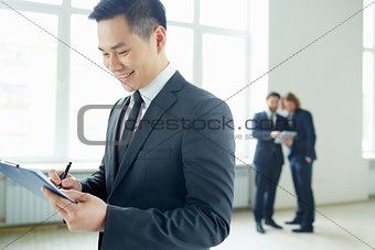 Businessman writing plan