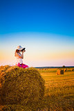 Beautiful Young Girl Woman In Dress Sitting On Haystack