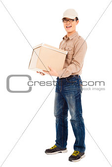 smiling  delivery man holding parcel and standing