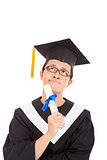 confusing graduation man thinking  and holding diploma