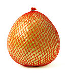 Pomelo fruit wrapped in red plastic reticle isolated on white