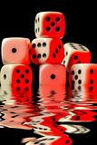 sinking pile of red illuminated white dice