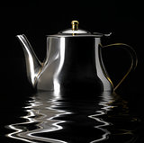 sinking metallic tea pot