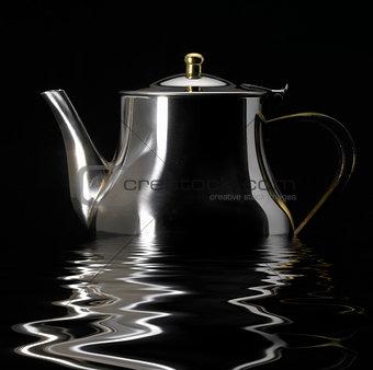 sinking metallic tea pot