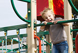 Boy on playground equipment.