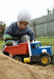 Boy playing with toy truck outdoor