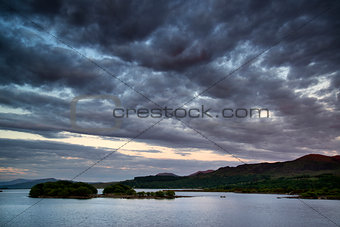 Beautiful moody sunrise over calm lake