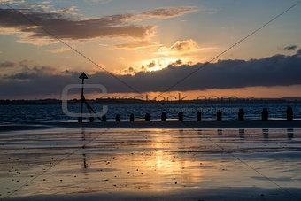 Beautiful landscape Summer sunset sky reflected on wet beach at
