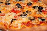 Pizza with black olives and melted cheese, close-up shooting
