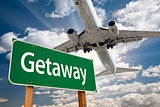Getaway Green Road Sign and Airplane Above