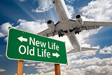New Life, Old Life Green Road Sign and Airplane Above