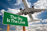 The Sky Is The Limit Green Road Sign and Airplane