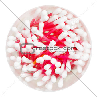 top view of many pink cotton swabs in container