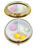 compact pill box with several tablets