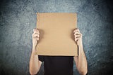 Man holding blank cardboard paper