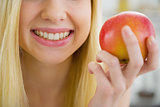 Closeup on young woman holding apple
