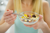 Closeup on young woman eating healthy breakfast