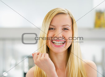 Portrait of smiling young woman in kitchen
