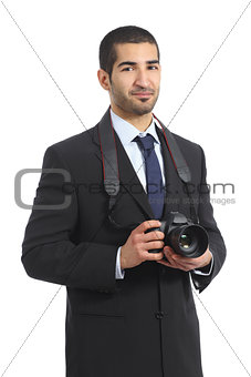 Arab professional photographer holding a dslr digital camera
