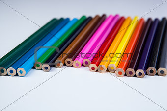 a stack of colored pencils