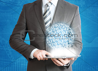 Man holding tablet pc and digital sphere in hand