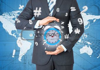 Man in suit holding alarm clock in hand